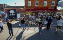 Visitors look at a memorial at the site of the arrest of George Floyd, who died while in police custody, in Minneapolis,June 14, 2020.