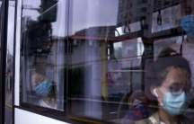 Women wearing protective face masks are seen in a bus, following the coronavirus disease (COVID-19) outbreak, in Shanghai,June 9, 2020.