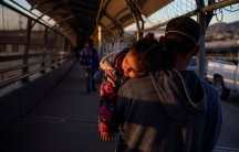 A migrant father and child returns to CiudadJuárezafter he had his family'scourtdates changed by Customs and Border Protection on the Paso del Norte International Bridge aftercourtcancelations amid the coronavirus disease (COVID-19) outbreak in Ciud