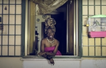 """A screenshot from Liberian Italian artist Karima 2G's 2014 music video, """"Bunga Bunga,"""" in which she raps about racism and objectification of women."""