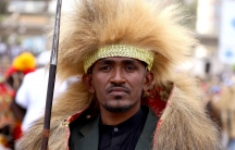 A close up of a man in traditional Oromo clothing