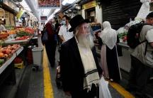 People wear face masks as they shop in a main market in Jerusalem, Israel, July 16, 2020.
