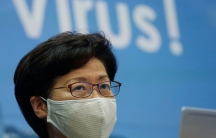 A close-up photograph of Hong Kong Chief Executive Carrie Lam who is shown wearing a face mask and glasses.