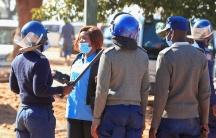 A nurse talks with police.