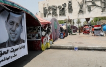 A poster depicting the former government adviser and politicalanalyst Husham al-Hashimi, who was killed by gunmen, is seen in Tahrir Square in Baghdad, July 8, 2020.
