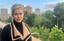 Wearing a beige and black sweater, Belarusian opposition figure Veronika Tsepkalo stands on a roof deck in Moscow while in exile from her country.