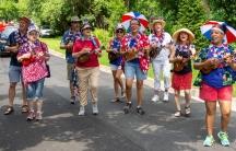 A Maryland-based ukulele marching band performsduring a 2019 Fourth of July parade.