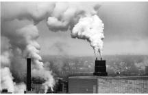 gray and white smokestacks billow