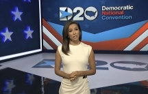 In this image from video, Eva Longoria, serving as moderator in a white dress against a blue screen, speaks during the first night of the Democratic National Convention on Aug. 17, 2020.