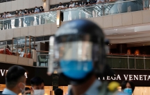 Riot police patrol at a shopping mall during aprotest afterChina's parliament passes a national security law for Hong Kong, in Hong Kong,June 30, 2020.