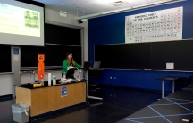 Sections of a table are seen blocked off with tape as assistant professor Jennifer Guerard speaks into laptops while teaching a foundations of chemistry remote class at the USNaval Academy, Aug. 24, 2020, in Annapolis, Md.