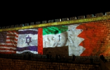 National flags of Bahrain,UAE, Israel and the USare projected onto the walls of Jerusalem's Old city, Sept.15, 2020.