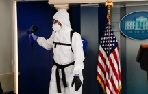 With full-body PPE and disinfecting equipment, a member of theWhiteHousecleaning staff sprays the press briefing room the evening of USPresident DonaldTrump's return from Walter Reed Medical Center, in Washington, DC, Oct.5, 2020.