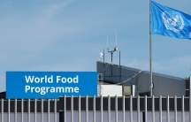 The World Food Program's flag flutters on the roof of WFP headquaters after the organization won the 2020 Nobel Peace Prize, in Rome, Italy, Oct. 9, 2020.