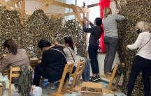 Women volunteers construct camouflage nets to be used on the Nagorno-Karabakhfrontlines.