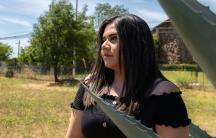 Marlene Herrera in front of her home