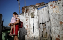 Gleyse Kelly da Silva, 28, holds her 2-year-old daughter Maria Giovanna at their house in Recife,Brazil, Aug.8, 2018.