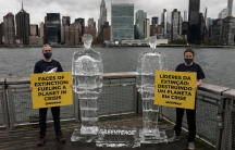 Greenpeace activists hold signs between two ice sculptures depicting USPresident DonaldTrumpandBrazil's President Jair Bolsonaro across the Hudson River from UNheadquarters in the Queens borough of New York City, Sept. 30, 2020.