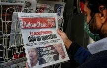 A man reads the headline about the US presidential electionat a newspaperstand in Paris, France, Nov. 4, 2020.