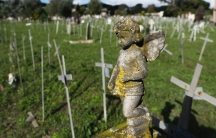 Crosses bearing tags with names are seen in a graveyard of the Flaminio Cemetery, in Rome, Italy, Oct. 16, 2020.