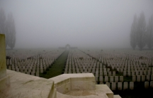 Dozens of rows of headstones are shown in rows at the Tyne Cot cemetery.