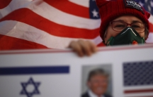 A supporter of USPresident Donald Trump waves Israeli and US national flags on the day of the U.S. presidential election, in Carmiel, northern Israel, Nov. 3, 2020.
