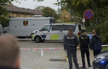 Police officers are seen as Peter Madsen (not pictured) is surrounded by the police in Albertslund, Denmark, Oct.20, 2020.