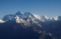 MountEverest, the world highest peak, and other peaks of the Himalayan range are seen through an aircraft window during a mountain flight from Kathmandu, Nepal, Jan.15, 2020.