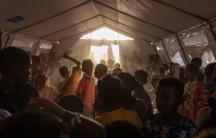 Tigray refugee children sing and dance inside a tent run by UNICEF for children's activities, in Umm Rakouba refugee camp in Qadarif, eastern Sudan, Thursday, Dec. 10, 2020.