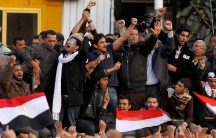 In this Feb. 8, 2011, file photo, a leader of Egypt's anti-government protesters, Egyptian Wael Ghonim, center, 30, a Google Inc. marketing manager who was a key organizer of the online campaign that sparked the first protest on Jan. 25.