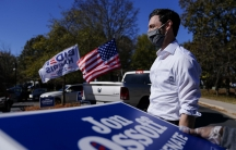 Georgia Democratic candidate for USSenate Jon Ossoff waits for a supporter to arrive during a drive-through yard sign pick-up event onNov. 18, 2020, in Marietta, Georgia.