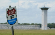In this Aug. 28, 2020, file photo, a no-trespassing sign is displayed outside the federal prison complex in Terre Haute, Ind. As Donald Trump's presidency winds down, his administration is throttling up the pace of federal executions despite a surge of CO