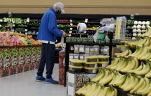 Man shopping in the produce section of an American grocery store