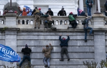 Supporters of President Donald Trump climb the West wall of the the US Capitol on Wednesday, Jan. 6, 2021, in Washington, DC.