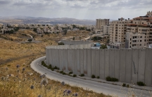 A view of Shuafat refugee camp is seen behind section of Israel's separation barrier in Jerusalem, June 19, 2020.