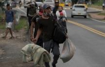 A Venezuelan migrant family walks away from the Venezuelan border in Pamplona, Colombia, Oct. 7, 2020.