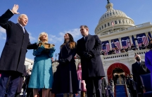Joe Biden is sworn in as the 46th president of the United States by Chief Justice John Roberts as Jill Biden holds the Bible during the 59th Presidential Inauguration at the USCapitol in Washington,Jan. 20, 2021.