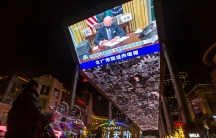 A jumbotron shown from below has newly inaugurated US President Joe Biden on screen.