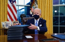 President Joe Biden signs his first executive orders in the Oval Office of the White House in Washington on Jan. 20, 2021. Six of Biden's 17 first-day executive orders dealt with immigration, such as halting work on a border wall in Mexico and lifting a t