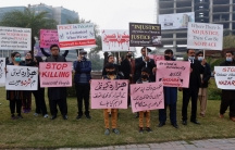 Supporters of a civil society organization hold a demonstration to protest against the killing of coal mine workers by gunmen near the Machh coal field, in Lahore, Pakistan,Jan. 8, 2021. Pakistan's prime minister Friday appealed to the protesting minorit