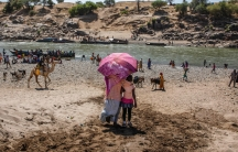 Refugees who fled the conflict in Ethiopia's Tigray region arrive on the banks of the Tekeze River on the Sudan-Ethiopia border, in Hamdayet, eastern Sudan,Nov. 21, 2020.Huge unknowns persist in the deadly conflict, but details of the involvement of nei