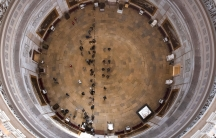 The Rotunda to the Senate is shown looking down from above with the complete circle of the space framing the composition.
