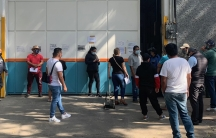 People waitin a long line at an oxygen distribution warehouse near downtown Mexico City.