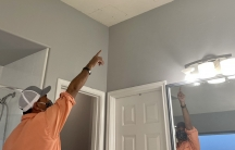 Houston plumber Eduardo Dolande said he had to cut holes in his bathroom ceiling to reach broken pipes during the Texas freeze.