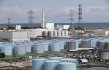 Nuclear reactors of No. 5, center left, and 6 look over tanks storing water that was treated but still radioactive, at the Fukushima Daiichi nuclear power plant