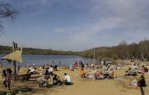 People enjoy the warm weather at Ruislip Lido in London, March 30, 2021. Temperatures in parts of the UK are expected to be significantly warmer this week as families and friends are reunited and outdoor sporting activities are allowed to resume in Englan