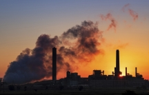 In this July 27, 2018, photo the Dave Johnson coal-fired power plant is silhouetted against the morning sun.