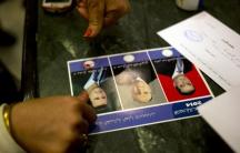 A woman votes for President Bashar al-Assad