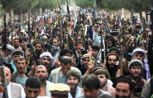 Afghan militiamen join Afghan defense and security forces during a gathering in Kabul, Afghanistan, June 23, 2021. Afghanistan's defense ministry is working with warlords to mobilize local militias across the country, most particularly in the north, to tr