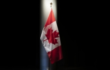 The Canadian flag is illuminated in the Embassy of Canada in Washington in Washington, Thursday, June 20, 2019.